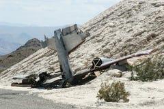 Plane crash. Crashed plane, tail sticking on the ground Royalty Free Stock Photos