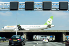 Plane Crossing Highway Royalty Free Stock Images