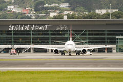 Plane Departing. A Boeing 737 departs from Wellington International Airport Stock Photos
