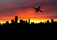 Plane departing Miami at sunset Royalty Free Stock Image