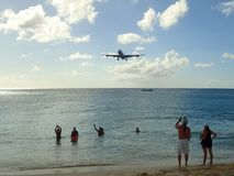 A plane is descending towards Princess Juliana International Airport SXM over the beach Stock Photography