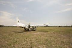 Plane on dirt runway Stock Photography