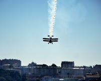Plane doing stunts and dropping smoke Stock Photography