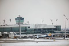 Aegean and Trade Air planes moving in Munich Airport, Germany. Plane doing taxi on Munich Airport, winter time, snow on runways stock photo
