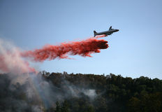 Plane Drops Fire Retardant Royalty Free Stock Photo