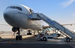 Plane in Dubai airport Stock Images