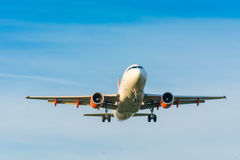 Plane from Easyjet Airbus A319-100 G-EZGA is preparing for landing stock image