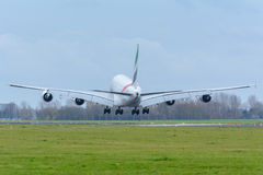 Plane from Emirates A6-EEW Airbus A380-800 is landing at Schiphol Airport. Stock Photography