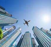Plane encircled by buildings Stock Images