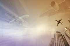 Plane encircled by buildings. Plane soaring high in the sky encircled by skyscrapers Royalty Free Stock Image