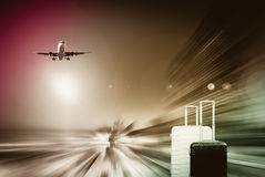 Plane encircled by buildings. Plane soaring high in the sky encircled by skyscrapers Stock Photography