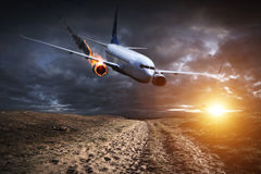 Plane with engine on fire about to crash Stock Images