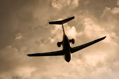 Plane in the evening sky. Russian midrange airplane Yak, making a turn in the evening sky during landing royalty free stock images