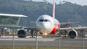 Plane at the executive. PHUKET, THAILAND - NOVEMBER 26, 2015: Air Asia Airbus HS-BBE turn at the executive before take-off stock footage