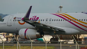 Plane at the executive. PHUKET, THAILAND - NOVEMBER 26, 2015: Thai Smile Airbus 320 HS-TXO turn to the executive and begin accelerate, before take-off stock video