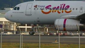 Plane at the executive. PHUKET, THAILAND - NOVEMBER 26, 2015: Thai Smile Airbus 320 HS-TXO turn to the executive, before take-off stock video
