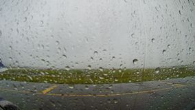 The plane expects to depart at the Boston Logan International airport during the rain Massachusetts, USA.
