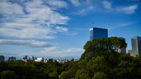 A plane flew over the cbd near the castle tower in Osaka Castle. ,Sunny weather, blue sky Stock Photo