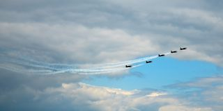 The plane flies against the blue sky and clouds. Demonstration performances. the plane flies against the blue sky and clouds stock image