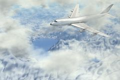 Plane flies high in mountain Stock Photo