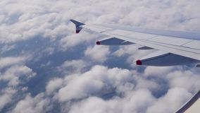 Plane flies highly over Earth and clouds stock video footage