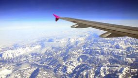 Plane flies over the Alps stock video footage