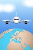 Plane flies over globe. Royalty Free Stock Photo