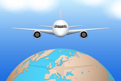 Plane flies over globe. Stock Photos