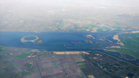 The plane flies over Netherlands on approaching the Amsterdam. Werkhaven IJsseloog. Top view stock video footage