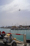 The plane flies over the port of Heraklion Royalty Free Stock Image