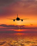 Plane flies over the sea Royalty Free Stock Image