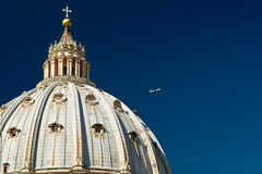 The plane flies over St. Peter's Basilica dome. Vatican, Italy Royalty Free Stock Photo