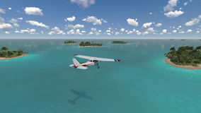 Plane flies over tropical islands Royalty Free Stock Image