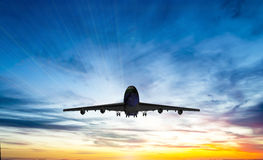 The plane flies in the sky against the background of clouds Royalty Free Stock Photo