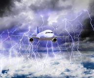 The plane flies through a storm with lots of lightning stock photo
