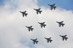 Plane, flight perfect formation. Plane, synchronised team flight - flying in formations. Fighter planes in front of a cloud Royalty Free Stock Images