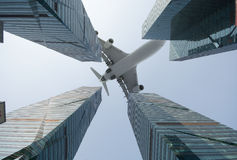 Plane fly above the modern city Royalty Free Stock Photography