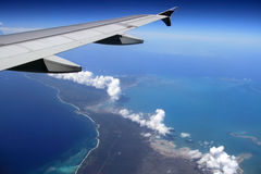 Plane fly. Above tropical island Stock Image