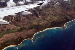 Plane fly. Ing above Dominican island Stock Photography