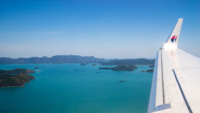 Plane fly over islands Royalty Free Stock Image
