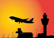 Plane flying above airport Stock Images