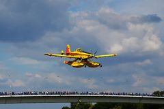 Plane flying above bridge over the river Danube in an exhibition on airshow royalty free stock image