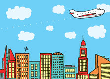 Plane flying above the city Stock Images