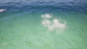 Plane flying above ocean surface realistic footage