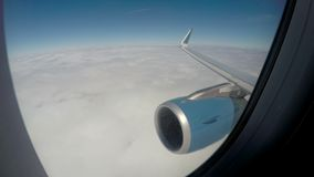 Plane flying above thick white clouds in tranquil blue sky, vacation travel. Stock footage stock video