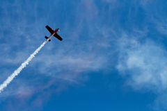Plane flying against the sky Stock Images