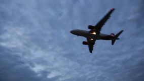 Plane flying against the sky stock footage