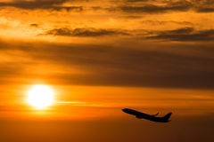 A plane flying at beautiful sunset Stock Photo