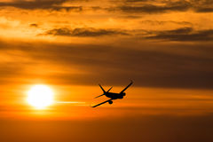 A plane flying a beautiful sunset Royalty Free Stock Image