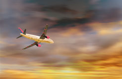 A plane flying at beautiful sunset Stock Images